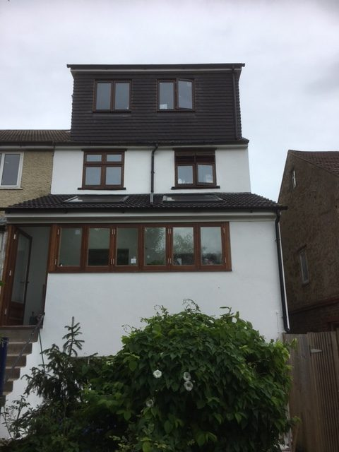 complete house finished top to toe with loft conversion , rear extension and render
